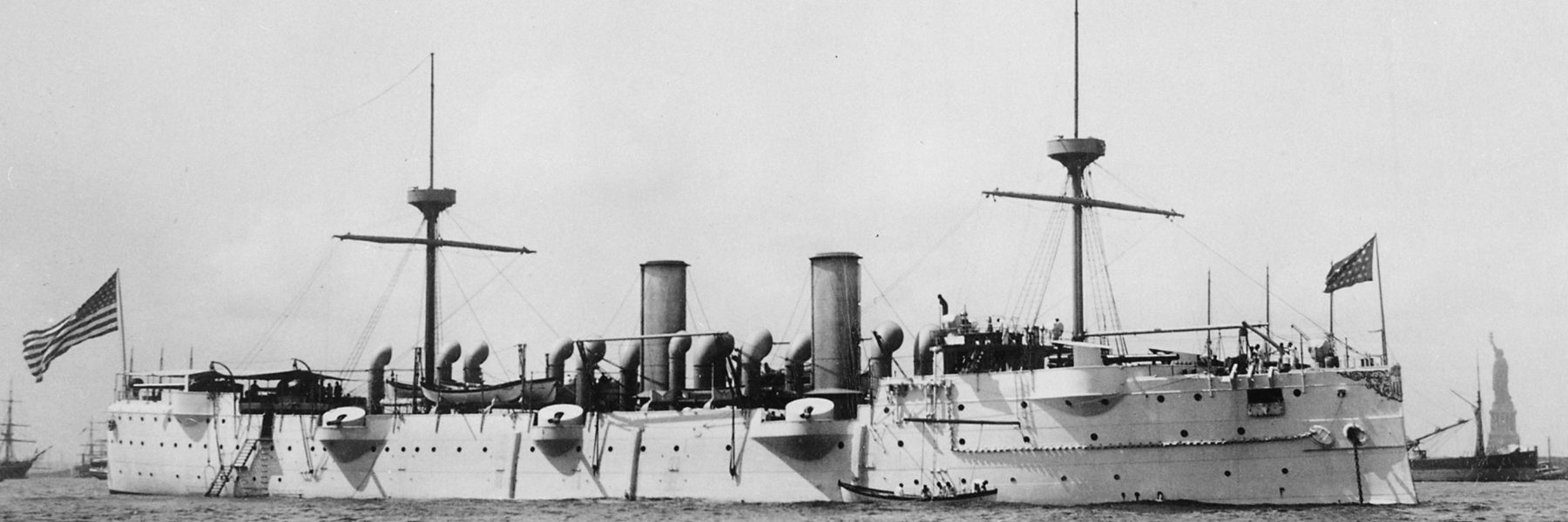 USS baltimore in New York - Statue of Liberty can be seen to the right in the foreground.