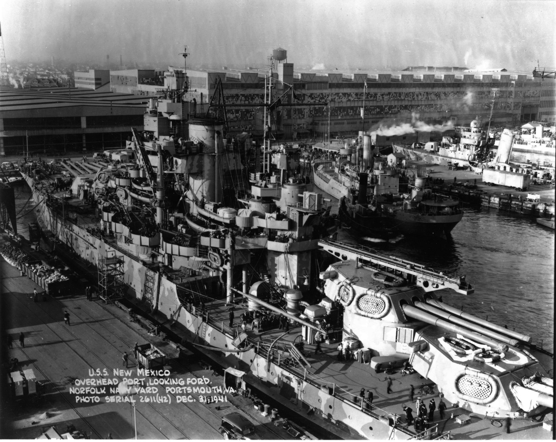 USS New mexico at Puget Sound in 1942, with the stopped grey camouflage of the time