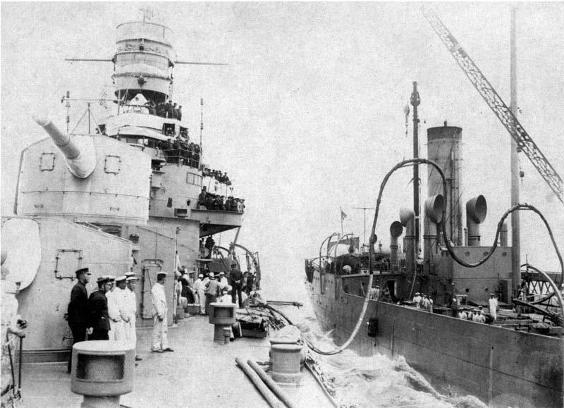 IJN Furutaka refuelling at sea alongside the gunboat Tsurumi.