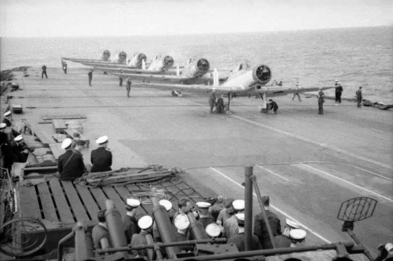 HMS Ark Royal planes preparing to depart for the harbor