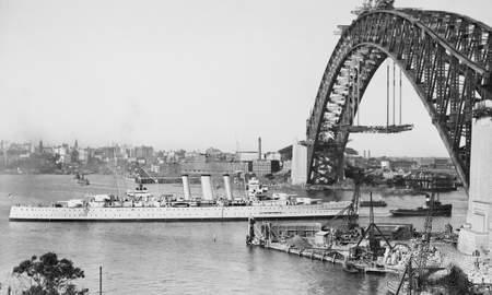HMAS Camberra under the Sydney bridge in 1930