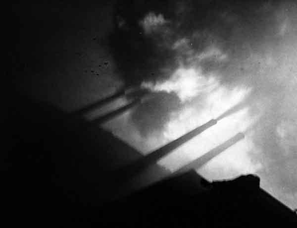 BB-35 guns blazing at Pointe du Hoc