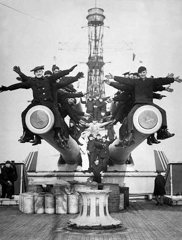 BB-35 crew on top of the forward main turret's guns