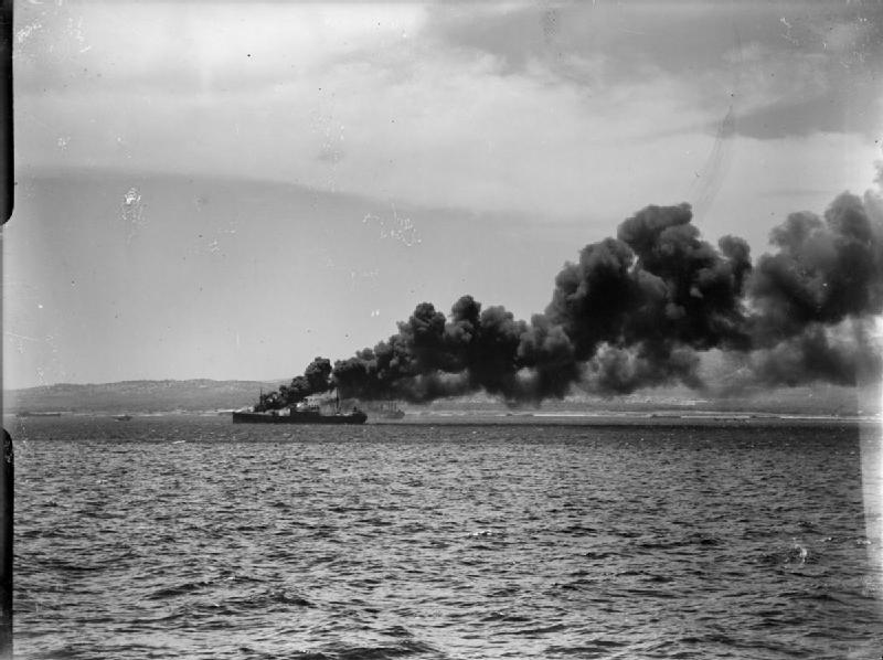 An ammunition ship of the Royal navy hit by aviation, burning four miles south of Syracuse