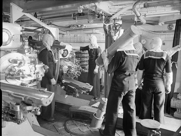 Gunner and loaders inside HMS Jamaica's turret