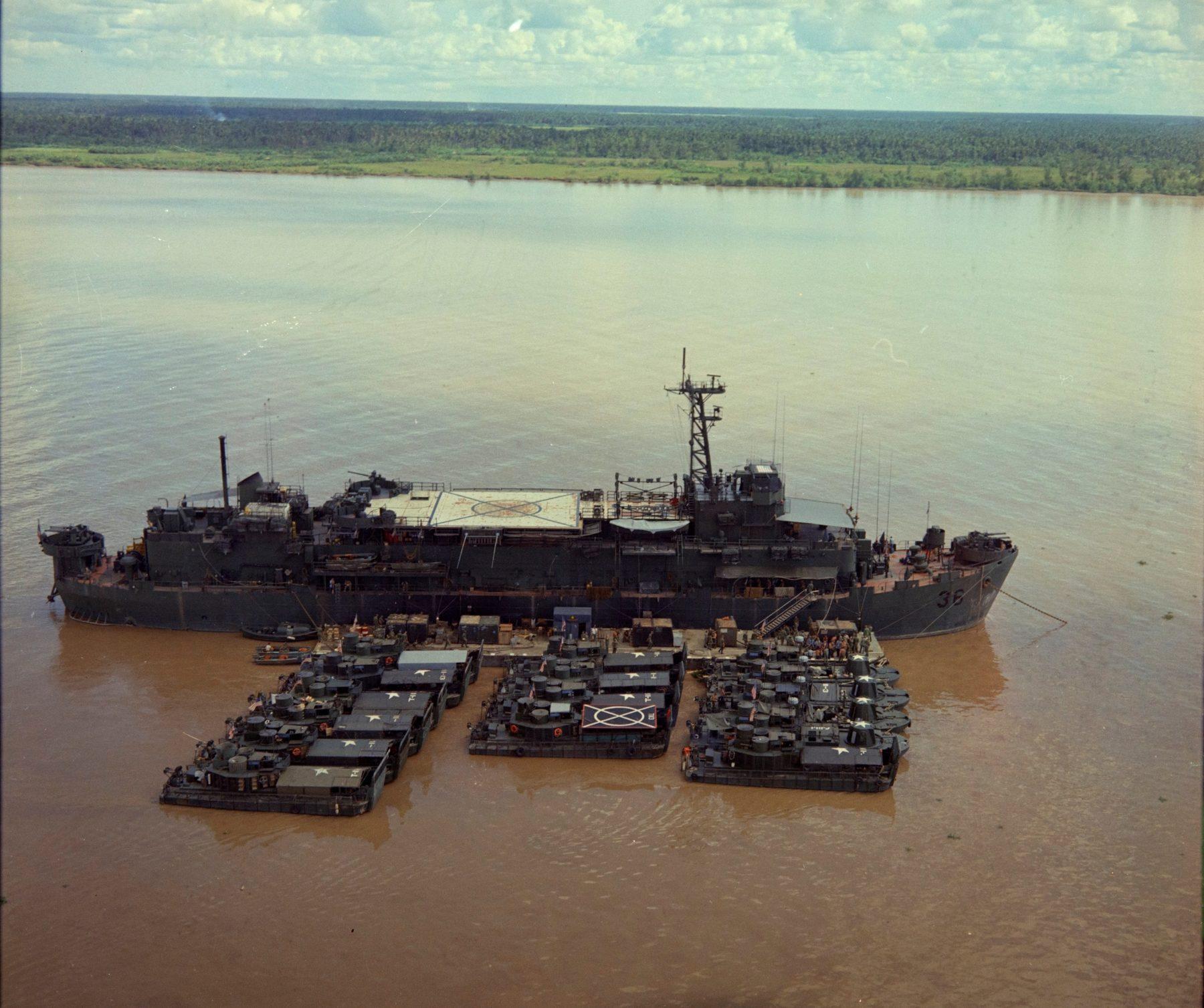NARA USS Benewah and smaller craft on My Tho River circa 1967