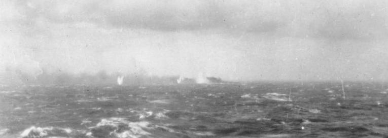Battleship_Bismarck_burning_and_sinking