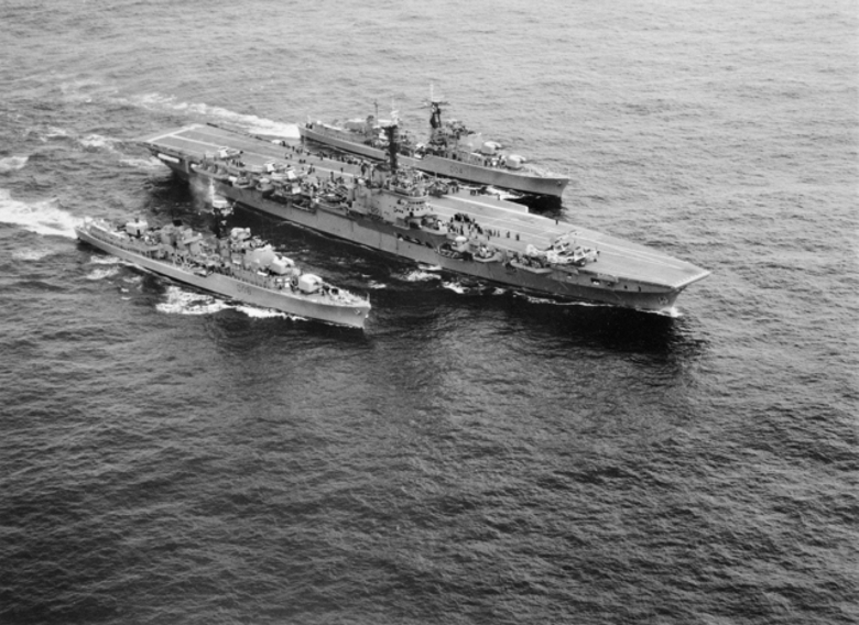 HMAS Melbourne, escorted by HMAS Voyager and HMAS Vendetta