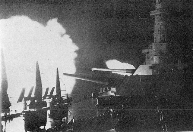 USS Washington, winner of her duel with IJN Kirishima, opening fire at the early hours of November 1942