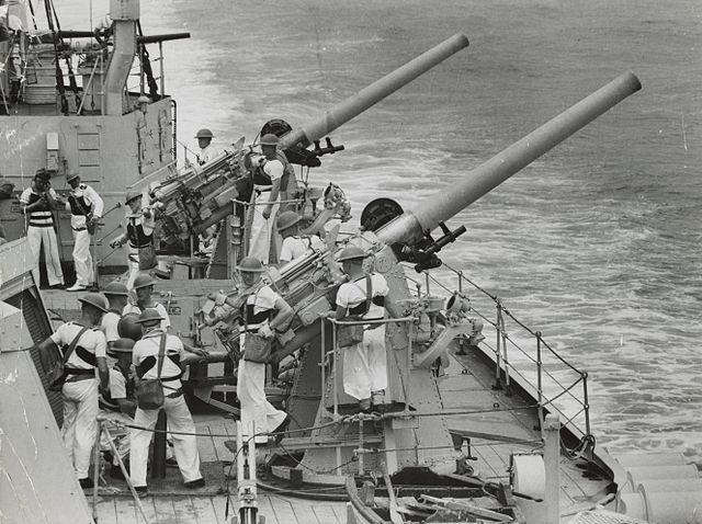HMAS Sydney's 4-in guns in action
