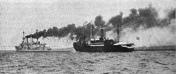 Prinz Heinrich coaling from the collier Hermann Sauber