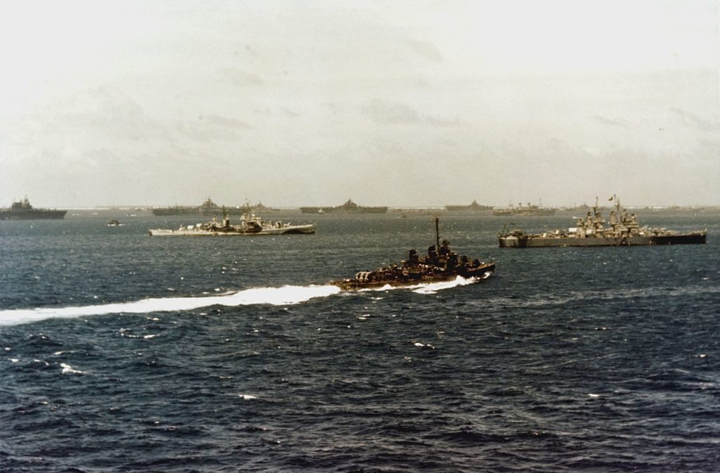 USS Flint and Shannon and carriers of TF 38 resplenishing between operations at Ulythi atoll, March 1945