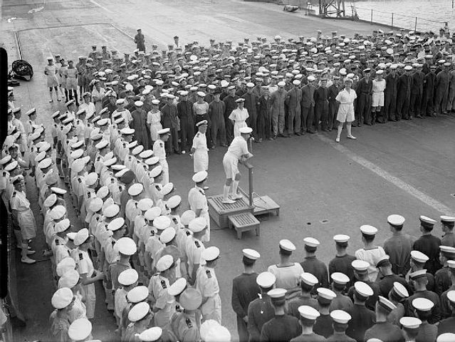Admiral Sommerville congratulating Ark Royal's crew
