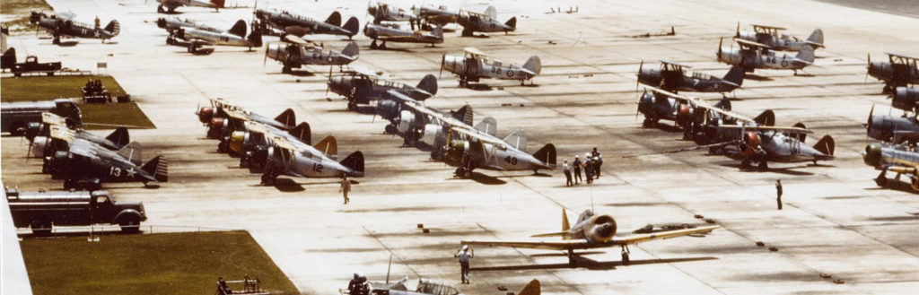 Training aircraft, including the F3F at Naval Air Station Miami, circa 1942