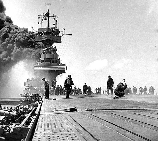 Smoke pours from Yorktown after being hit in the boilers by Japanese dive bombers at Midway